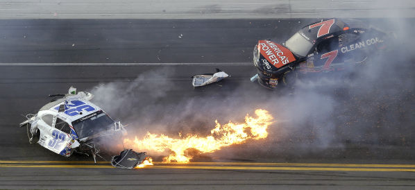 Kyle Larson, left, slides to a stop near Regan Smith &#40;7&#41; after a wreck at the conclusion of the NASCAR Nationwide Series auto race Saturday, Feb. 23, 2013, at Daytona International Speedway in Daytona Beach, Fla. &#40;AP Photo&#47;Chris O&#39;Meara&#41; <span class=meta>(AP Photo&#47; Chris O&#39;Meara)</span>