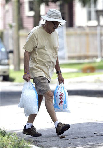 Larry Fabacher carries bags of ice to his home as he prepares for Tropical Storm Isaac Monday, Aug. 27, 2012, in New Orleans. Isaac is churning it&#39;s way across the Gulf of Mexico. <span class=meta>(AP Photo&#47; David J. Phillip)</span>