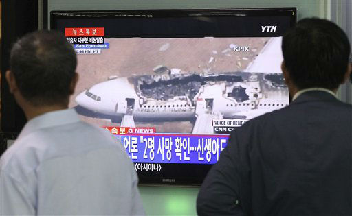 "<div class=""meta image-caption""><div class=""origin-logo origin-image ""><span></span></div><span class=""caption-text"">People watch a news program reporting about Asiana Airlines flight 214 which took off from Seoul and crashed while landing at San Francisco International Airport, at Seoul Railway Station in Seoul, South Korea, Sunday, July 7, 2013.  The writing on the screen reads "" Local media saying two people died.""  (AP Photo/Ahn Young-joon) (AP Photo/ Ahn Young-joon)</span></div>"