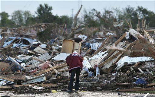 "<div class=""meta image-caption""><div class=""origin-logo origin-image ""><span></span></div><span class=""caption-text"">A local resident allowed looks through the rubble of a destroyed home, one day after a tornado moved through Moore, Okla., Tuesday, May 21, 2013.  Emergency crews searched the broken remnants of an Oklahoma City suburb Tuesday for survivors of a massive tornado that flattened homes and demolished an elementary school. (AP Photo/Brennan Linsley) (AP Photo/ Brennan Linsley)</span></div>"