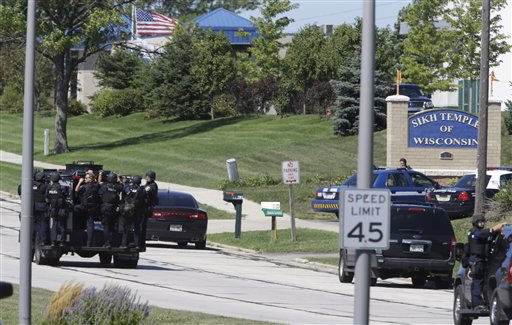 "<div class=""meta ""><span class=""caption-text "">Police personnel move outside the Sikh Temple in Oak Creek, Wis., where a shooting took place Sunday, Aug 5, 2012.   (AP Photo/ JEFFREY PHELPS)</span></div>"