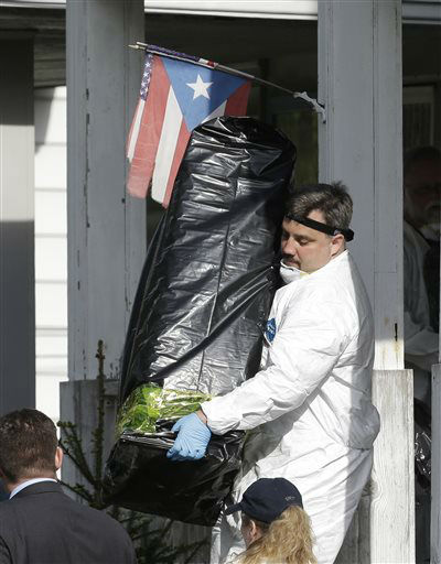 A member of the FBI evidence response team carries out evidence from a house Tuesday, May 7, 2013, where three women who vanished a decade ago were held, in Cleveland. The women were found safe Monday, and police arrested three brothers accused of holding the victims against their will.   <span class=meta>(AP Photo&#47; Tony Dejak)</span>