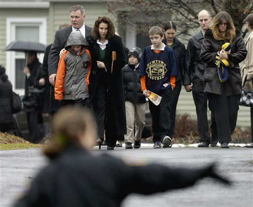 Mourners leave the funeral service of Sandy Hook Elementary School shooting victim, Jack Pinto, 6, Monday, Dec. 17, 2012, in Newtown, Conn. Pinto was killed when a gunman walked into Sandy Hook Elementary School in Newtown Friday and opened fire, killing 26 people, including 20 children.&#40;AP Photo&#47;David Goldman&#41; <span class=meta>(AP Photo&#47; David Goldman)</span>