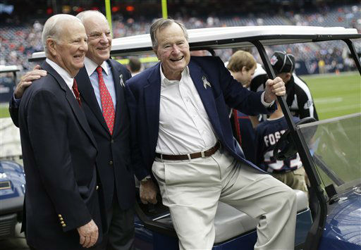 Former President George H. W. Bush, right, former Secretary of State James Baker, left,  and Houston Texans owner Bob McNair pose together before an NFL football game against the Buffalo Bills Sunday, Nov. 4, 2012, in Houston.   <span class=meta>(AP Photo&#47; Eric Gay)</span>