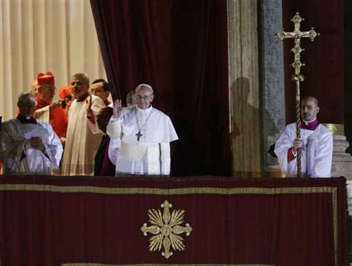 "<div class=""meta ""><span class=""caption-text "">Pope Francis flanked by Monsignor Guido Marini, master of liturgical ceremonies, waves to the crowd from the central balcony of St. Peter's Basilica at the Vatican, Wednesday, March 13, 2013. Cardinal Jorge Bergoglio, who chose the name of Francis is the 266th pontiff of the Roman Catholic Church.   (AP Photo/ Andrew Medichini)</span></div>"