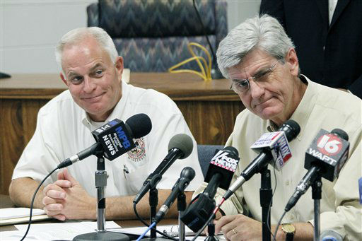 Harrison County Emergency Management Agency Director Rupert Lacy, left, listens as Gov. Phil Bryant discusses Gulf Coast preparations for Tropical Storm Isaac during a news conference at the Harrison County Emergency Operations Center in Gulfport, Miss., Monday, Aug. 27, 2012.   <span class=meta>(AP Photo&#47; Rogelio V. Solis)</span>