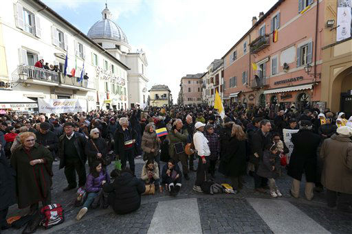 Faithful gather in front of Pope&#39;s summer residence of Castel Gandolfo, the scenic town where Pope Benedict XVI will spend his first post-Vatican days and make his last public blessing as pope,Thursday, Feb. 28, 2013. <span class=meta>(AP photo)</span>