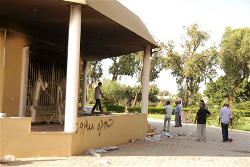 "<div class=""meta image-caption""><div class=""origin-logo origin-image ""><span></span></div><span class=""caption-text"">Libyans gather at the gutted U.S. consulate in Benghazi, Libya, after an attack that killed four Americans, including Ambassador Chris Stevens, Wednesday, Sept. 12, 2012. The American ambassador to Libya and three other Americans were killed when a mob of protesters and gunmen overwhelmed the U.S. Consulate in Benghazi, setting fire to it in outrage over a film that ridicules Islam's Prophet Muhammad. Ambassador Chris Stevens, 52, died as he and a group of embassy employees went to the consulate to try to evacuate staff as a crowd of hundreds attacked the consulate Tuesday evening, many of them firing machine-guns and rocket-propelled grenades. Partial graffiti reads, ""Hamza.""(AP Photo/Ibrahim Alaguri) (AP Photo/ Ibrahim Alaguri)</span></div>"