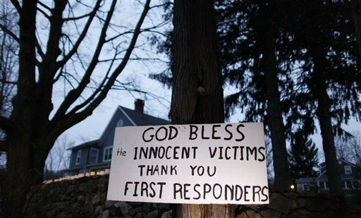 "<div class=""meta image-caption""><div class=""origin-logo origin-image ""><span></span></div><span class=""caption-text"">A message of thanks and prayer is displayed outside a home in the wake of a deadly school shooting, Sunday, Dec. 16, 2012, in Newtown, Conn. A gunman walked into Sandy Hook Elementary School in Newtown on Friday and opened fire, killing 26 people, including 20 children. (AP Photo/Jason DeCrow)</span></div>"