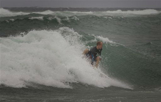 "<div class=""meta image-caption""><div class=""origin-logo origin-image ""><span></span></div><span class=""caption-text"">A surfer at the Boynton Beach, Fla. inlet battles the rough surf Thursday, Oct. 25,2012. Hurricane Sandy was expected to churn through the central and northwest Bahamas late Thursday and early Friday. It also might bring tropical storm conditions along the southeastern Florida coast, the Upper Keys and Florida Bay by Friday morning.   (AP Photo/ J Pat Carter)</span></div>"