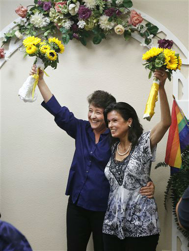 Nicola Simmersbach, left, and Diana Luiz celebrate after they were married at the Sacramento County Recorder&#39;s office Friday, June 28, 2013, in Sacramento, Calif.  A three-judge panel of the 9th U.S. Circuit Court of Appeals issued a brief order Friday afternoon dissolving, &#34;effective immediately,&#34; a stay it imposed on gay marriages while the lawsuit challenging the ban advanced through the court.  The couple had been engaged for five years and rushed to the recorders office where they became the first same-sex couple to get be married in Sacramento County after the ruling.  <span class=meta>(AP Photo&#47; Rich Pedroncelli)</span>