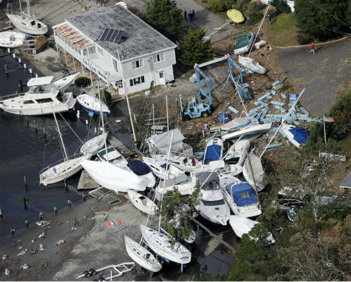 In this aerial photo, upended boats are piled together at a marina along the central New Jersey shore on Wednesday, Oct. 31, 2012. New Jersey got the brunt of superstorm Sandy, which made landfall in the state and killed six people. More than 2 million customers were without power as of Wednesday afternoon, down from a peak of 2.7 million.   <span class=meta>(AP Photo&#47; Mike Groll)</span>