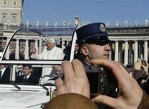 "<div class=""meta ""><span class=""caption-text "">Pope Benedict XVI is driven through the crowd in his pope-mobile as he arrives to celebrate his last general audience in St. Peter's Square, at the Vatican, Wednesday, Feb. 27, 2013. Benedict XVI basked in an emotional sendoff Wednesday at his final general audience in St. Peter's Square, recalling moments of ""joy and light"" during his papacy but also times of great difficulty. He also thanked his flock for respecting his decision to retire.   (AP Photo/ Alessandra Tarantino)</span></div>"