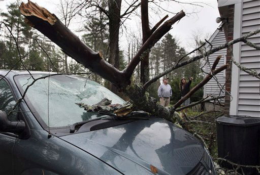 Bill Hughes and Priscilla Martell examine damage, Tuesday, Oct. 30, 2012, after a tree limb smashed the windshield of a van and punctured the roof of the Deering Road group home during superstorm Sandy in Gorham, Maine. Sandy made landfall Monday, caused multiple fatalities, halted mass transit and cut power to more than 6 million homes and businesses.   <span class=meta>(AP Photo&#47; Robert F Bukaty)</span>