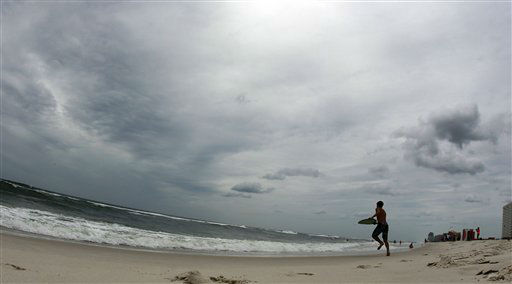 A boy plays in the surf in waves ahead of Tropical Storm Isaac in Orange Beach, Ala., Monday, Aug. 27, 2012. Forecasters predicted Isaac would intensify into a Category 1 hurricane by Tuesday with top sustained winds of between 74 and 95 mph.   <span class=meta>(AP Photo&#47; John Bazemore)</span>