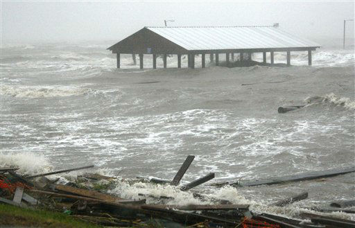 "<div class=""meta ""><span class=""caption-text "">Gulf waters swamp an American Legion fishing pier in Bay St. Louis, Miss., as Isaac's winds and storm surge flood some low laying neighborhoods, Wednesday, Aug. 29, 2012, the seventh  anniversary of Hurricane Katrina hitting the Gulf Coast.  Isaac was packing 80 mph winds, making it a Category 1 hurricane. It came ashore early Tuesday near the mouth of the Mississippi River, driving a wall of water nearly 11 feet high inland and soaking a neck of land that stretches into the Gulf.  (AP Photo/ Rogelio V. Solis)</span></div>"