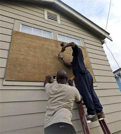 Stacey Davis, left, and his board up windows on their home before Tropical Storm Isaac hits Tuesday, Aug. 28, 2012, in New Orleans. Tropical Storm Isaac is churning it&#39;s way across the Gulf of Mexico towards New Orleans.   <span class=meta>(AP Photo&#47; David J. Phillip)</span>