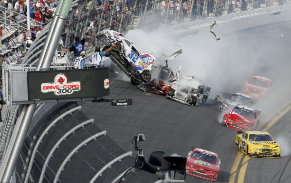 Kyle Larson&#39;s car &#40;32&#41; gets airborne during a multi-car wreck on the final lap of the NASCAR Nationwide Series auto race Saturday, Feb. 23, 2013, at Daytona International Speedway in Daytona Beach, Fla. Tony Stewart, in the red car at front, won the race. &#40;AP Photo&#47;David Graham&#41; <span class=meta>(AP Photo&#47; David Graham)</span>