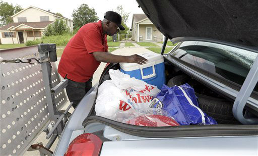 Charles Harris packs his car as he prepares to evacuate his Lower Ninth Ward home Monday, Aug. 27, 2012, in New Orleans. Harris&#39;s home was destroyed by Hurricane Katrina nearly seven years ago this week. Tropical Storm Isaac is churning it&#39;s way across the Gulf of Mexico and could make landfall near New Orleans later this week.  <span class=meta>(AP Photo&#47; David J. Phillip)</span>