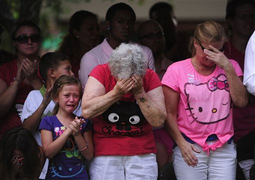 Family members of the victims of the Century 16 theater shooting remember their loved ones during a vigil at the Aurora Municipal Center campus in Aurora, Colo. Sunday, July 22, 2012. 12 people were killed and 58 were injured in a shooting during an early Friday premiere of ?The Dark Knight Rises.&#34; &#40;AP Photo&#47;The Denver Post, AAron Ontiveroz, Pool&#41; <span class=meta>(AP Photo&#47; AAron Ontiveroz)</span>