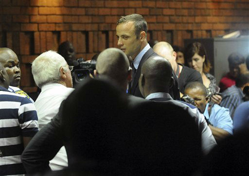 South African athlete Oscar Pistorius at the end of court proceedings,  in Pretoria, South Africa, Friday, Feb 15, 2013. Pistorius was formally charged at Pretoria Magistrate&#39;s Court with one count of murder after his girlfriend, Reeva Steenkamp, a model and budding reality TV show participant, was shot multiple times and killed at Pistorius&#39; upmarket home in the predawn hours of Thursday.   <span class=meta>(AP Photo&#47; Antoine de Ras)</span>