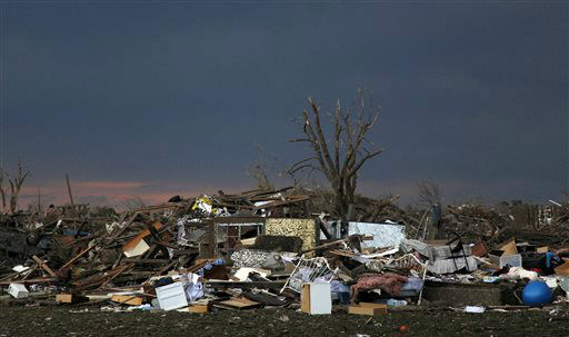 "<div class=""meta ""><span class=""caption-text "">The rubble of a destroyed neighborhood lay mixed together where it fell  Tuesday, May 21, 2013 a day after a tornado moved through Moore, Okla. The huge tornado roared through the Oklahoma City suburb Monday, flattening entire neighborhoods and destroying an elementary school with a direct blow as children and teachers huddled against winds. (AP Photo/Brennan Linsley) (AP Photo/ Brennan Linsley)</span></div>"