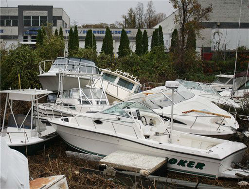 Pleasure boats pile up yards from shore in the wake of superstorm Sandy, Tuesday, Oct. 30, 2012, in the Cliffwood Beach section of Aberdeen, N.J. The storm&#39;s high winds and the high astronomical tide paired up to rip the boats away from their dock and deposit them on shore.  <span class=meta>(AP Photo&#47; Peter Hermann III)</span>