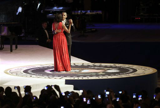 "<div class=""meta ""><span class=""caption-text "">President Barack Obama and first lady Michelle Obama dance together at the Commander-in-Chief's Inaugural Ball in Washington, at the Washington Convention Center during the 57th Presidential Inauguration Monday, Jan. 21, 2013.   (AP Photo/ Pablo Martinez Monsivais)</span></div>"