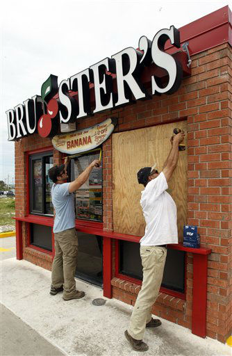 Daniel Shedd, left, and George Lopez board up a local Bruster&#39;s in Gulf Shores, Ala. on Monday, Aug. 27, 2012. The National Hurricane Center predicted Isaac would grow to a Category 1 hurricane over the warm Gulf and possibly hit late Tuesday somewhere along a roughly 300-mile &#40;500-kilometer&#41; stretch from the bayous southwest of New Orleans to the Florida Panhandle.?The size of the warning area and the storm&#39;s wide bands of rain and wind prompted emergency declarations in four states, and hurricane-tested residents were boarding up homes, stocking up on food and water or getting ready to evacuate.    <span class=meta>(AP Photo&#47; Butch Dill)</span>