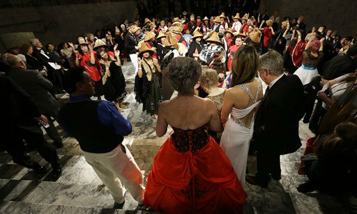 "<div class=""meta image-caption""><div class=""origin-logo origin-image ""><span></span></div><span class=""caption-text"">Guests at the Governor's Inaugural Ball view a performance by The Southern Salish Sea Canoe Families from the Nisqually, Squaxin and Chelhalis tribes, Wednesday, Jan. 16, 2013 at the Capitol in Olympia, Wash. to celebrate the inauguration of Washington Gov. Jay Inslee.   (AP Photo/ Ted S. Warren)</span></div>"
