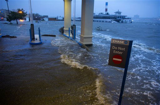 "<div class=""meta ""><span class=""caption-text "">Rising water from the Hudson River overtakes a bank drive through in Edgewater, N.J., Monday, Oct. 29, 2012 as Hurricane Sandy lashed the East Coast. In the background is the historic ferry boat named the Binghamton, swamped by the waves. Hurricane Sandy continued on its path Monday, as the storm forced the shutdown of mass transit, schools and financial markets, sending coastal residents fleeing, and threatening a dangerous mix of high winds and soaking rain.?(AP Photo/Craig Ruttle) (AP Photo/ Craig Ruttle)</span></div>"