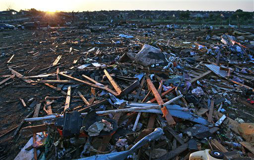 Debris litter a park adjacent to a neighborhood which was destroyed Monday when a tornado moved through Moore, Okla., Wednesday, May 22, 2013. The huge tornado roared through the Oklahoma City suburb, flattening a wide swath of homes and businesses.   <span class=meta>(AP Photo&#47; Brennan Linsley)</span>