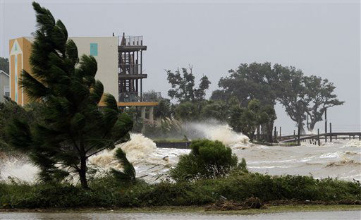 "<div class=""meta ""><span class=""caption-text "">Waves tear apart piers and crash into the back yards of homes along the Mobile Bay near Dauphin Island on Tuesday, August 28, 2012. Alabama took a glancing blow from Hurricane Isaac on Tuesday as it headed toward landfall in the northwestern Gulf of Mexico, but the storm still threatened the coast with high winds, torrential rain and pounding surf.   (AP Photo/ Butch Dill)</span></div>"