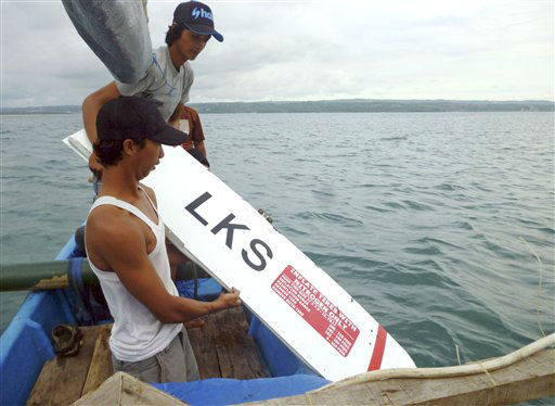 Indonesian fishermen hold a part of the wreckage of a Lion Air plane in Bali, Indonesia on Saturday, April 13, 2013. The plane carrying more than 100 passengers and crew overshot a runway on the Indonesian resort island of Bali on Saturday and crashed into the sea, injuring nearly two dozen people, officials said.   <span class=meta>(AP Photo&#47; Uncredited)</span>