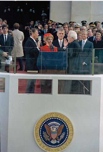 "<div class=""meta ""><span class=""caption-text "">Ronald Reagan is sworn in as the nation's 40th president by Chief Justice of the United States Warren Burger on the west front of the Capitol in Washington, D.C., Jan. 20, 1981. Shown from left are, Reagan, Nancy Reagan, Sen. Mark Hatfield, Burger, Rosalynn Carter, outgoing President Jimmy Carter, and Joan Mondale, wife of outgoing vice president.  (AP Photo) (AP Photo/ XNBG)</span></div>"