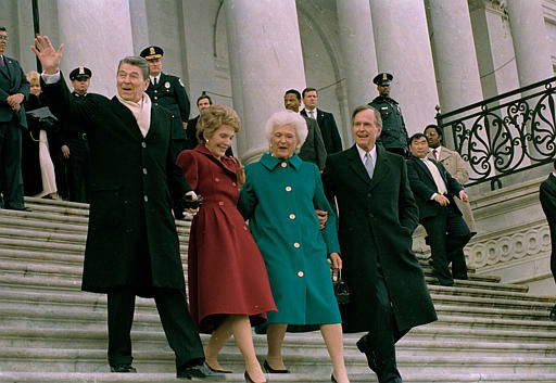"<div class=""meta ""><span class=""caption-text "">Former President Ronald Reagan, left, his wife Nancy Reagan, new first lady Barbara Bush and her husband President George Bush, right, walk down the Capitol steps after the inaugural ceremony in Washington, D.C., Friday, Jan. 20, 1989.  President Bush was sworn in as the nation's 41st president.  The Reagans are heading to an awaiting helicopter to take them to Andrews Air Force Base, Md., and onto California.    (AP Photo/ J. SCOTT APPLEWHITE)</span></div>"