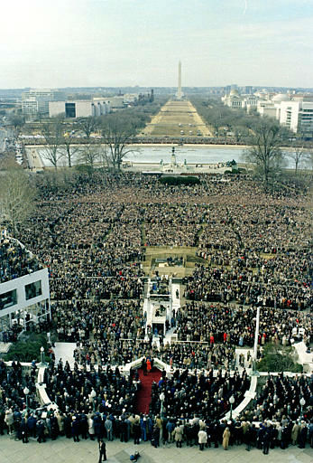 This aerial view shows the Inauguration Day ceremony as U.S. President Ronald Reagan and first lady Nancy Reagan wave to the crowd from the podium following swearing-in ceremony at the Capitol in Washington, D.C., Jan. 20, 1981.  Reagan was sworn in as the 40th president of the United States.  The Washington Monument is visible in the distant background.    <span class=meta>(AP Photo&#47; XNBG)</span>