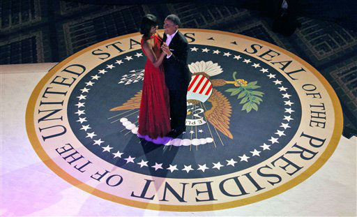 "<div class=""meta ""><span class=""caption-text "">President Barack Obama and first lady Michelle Obama dance at the Commander-in-Chief's Inaugural Ball in Washington, at the Washington Convention Center during the 57th Presidential Inauguration Monday, Jan. 21, 2013. (AP Photo/Pablo Martinez Monsivais) (AP Photo/ Pablo Martinez Monsivais)</span></div>"