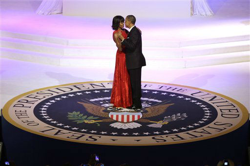 President Barack Obama and first lady Michelle Obama dance during the Commander-In-Chief Inaugural ball at the Washington Convention Center during the 57th Presidential Inauguration Monday, Jan. 21, 2013 in Washington.   <span class=meta>(AP Photo&#47; Evan Vucci)</span>