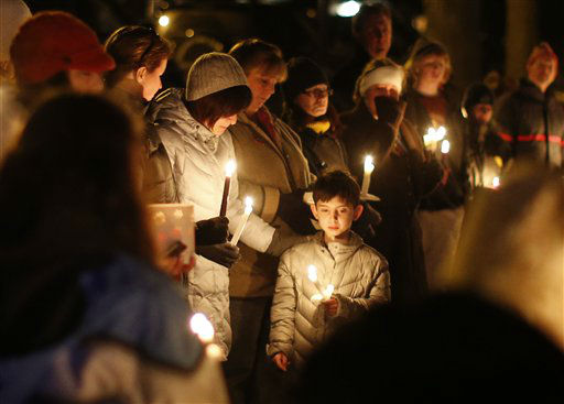 "<div class=""meta ""><span class=""caption-text "">Mourners gather for a candlelight vigil at Ram's Pasture to remember shooting victims, Saturday, Dec. 15, 2012 in Newtown, Conn. A gunman walked into Sandy Hook Elementary School in Newtown Friday and opened fire, killing 26 people, including 20 children. (AP Photo/Jason DeCrow)</span></div>"