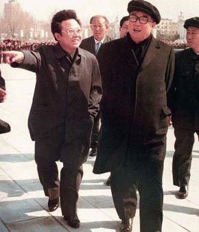 North Korean leader Kim Jong Il gestures while taking a stroll with his father Kim Il Sung, right, in this April, 1982  photo in Pyongyang.  1997. &#40;AP Photo&#47;Kyodo News&#41; <span class=meta>(AP Photo&#47; XCJ JAM TT)</span>