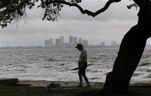 John Hassell walks his dog in between squalls blowing across Tampa Bay at Ballast Park in Tampa, Fla., Monday, Aug. 27, 2012. The Republican National Convention has delayed it&#39;s start because of the approaching tropical storm Isaac which is churning it&#39;s way across the Gulf of Mexico.   <span class=meta>(AP Photo&#47; Dave Martin)</span>