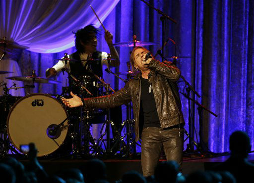 The Mexican pop rock band Man&#225; performs during the Inaugural Ball at the 57th Presidential Inauguration in Washington, Monday, Jan. 21, 2013. &#40;AP Photo&#47;Paul Sancya&#41; <span class=meta>(AP Photo&#47; Paul Sancya)</span>