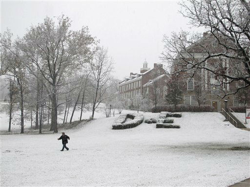 A student walks across the lawn at Davis &amp; Elkins College as the snow started falling hard in Elkins, W. Va., on Monday, Oct. 29, 2012. &#40;AP Photo&#47;Vicki Smith&#41; <span class=meta>(AP Photo&#47; Vicki Smith)</span>