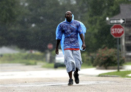 Terry Dickson walks through the streets of the Lower Ninth Ward as Hurricane Isaac moves closer Tuesday, Aug. 28, 2012, in New Orleans. Hurricane Isaac is churning it&#39;s way across the Gulf of Mexico heading towards Louisiana. The storm was arriving at the seventh anniversary of Hurricane Katrina, which devastated Louisiana and Mississippi when it struck on Aug. 29, 2005.   <span class=meta>(AP Photo&#47; David J. Phillip)</span>