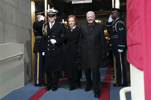 Former President Jimmy Carter and wife Rosalynn Carter arrive on the West Front of the Capitol in Washington, Monday, Jan. 21, 2013, for the Presidential Barack Obama&#39;s ceremonial swearing-in ceremony during the 57th Presidential Inauguration.  <span class=meta>(AP Photo&#47; Win McNamee)</span>