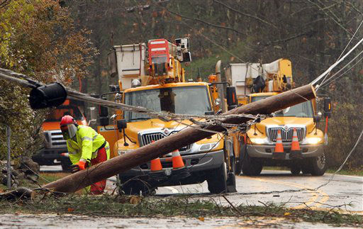 Crews work to clean up downed power lines in the aftermath of superstorm Sandy, Tuesday, Oct. 30, 2012, in Milton, N.H. Thousands of New Hampshire residents and businesses are without power. &#40;AP Photo&#47;Jim Cole&#41; <span class=meta>(AP Photo&#47; Jim Cole)</span>