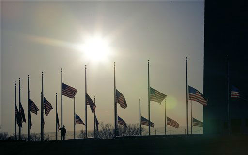 American flags surrounding the Washington Monument in Washington are lowered to half-staff in a mark of respect for the victims on the Connecticut elementary school shootings, Friday, Dec. 14, 2012.   <span class=meta>(AP Photo&#47; Alex Brandon)</span>