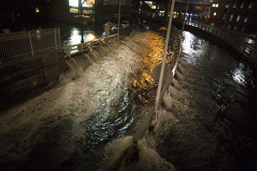 Sea water floods the entrance to the Brooklyn Battery Tunnel, Monday, Oct. 29, 2012, in New York. Sandy continued on its path Monday, as the storm forced the shutdown of mass transit, schools and financial markets, sending coastal residents fleeing, and threatening a dangerous mix of high winds and soaking rain.? &#40;AP Photo&#47; John Minchillo&#41; <span class=meta>(AP Photo&#47; John Minchillo)</span>