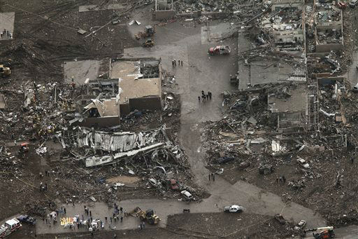 This aerial photo shows damage to buildings hit by a massive tornado in Moore, Okla., Monday May 20, 2013. A tornado roared through the Oklahoma City suburbs Monday, flattening entire neighborhoods, setting buildings on fire and landing a direct blow on an elementary school.   <span class=meta>(AP Photo&#47; Steve Gooch)</span>